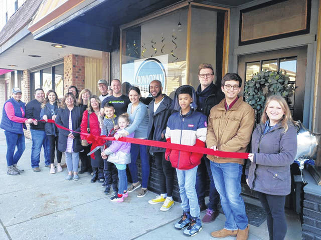 The Champaign County Chamber of Commerce held a ribbon-cutting Feb. 22 for Downtown Nutrition, 221 N. Main St., Urbana. From left are Tonia McGraw, Blair McConkey, Sonia McConkey, Shelby Phillips, Mary Collier, Carol Smith, Lori Rose, Dave Smith, Michael Ropp, Mason Ropp, Emma Ropp, Samantha Ropp, Desjuan Brown, Desjuan Brown, Justin Weller, Bret Skeel and Sara Neer.