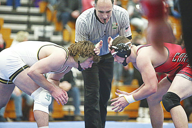 Triad's Isiah Leasure (right) wrestles Ben Logan's Steele Boysel during the Division III sectional at Lehman on Saturday. Boysel won the match, 14-4.