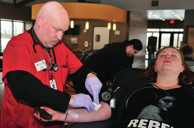 Jessica Broughton of Springfield donates blood as technician Craig Fry of the American Red Cross checks her progress at the Ohio Masonic Home in Springfield last week. The quarterly blood drive netted 48 pints. Donors from Miami, Clark, Champaign, Madison, and Montgomery Counties travel regularly to the OMH to give blood.