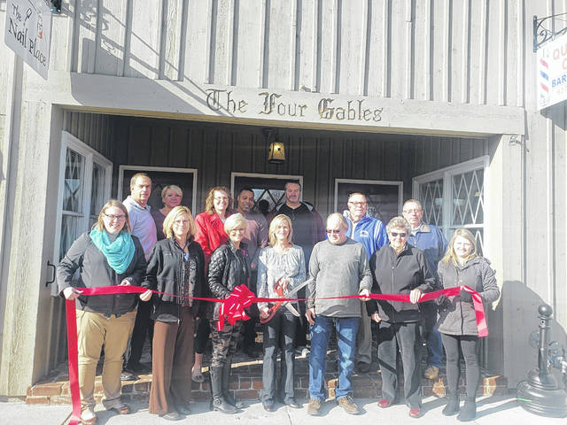 The Champaign County Chamber of Commerce held a ribbon-cutting for The Four Gables in November 2019. Located at 300 N. Main St. in downtown Urbana, the building now owned by Bob and Kim Arms was built in the late 1800s and has undergone numerous renovations while preserving its historical character. The structure houses apartments and Airbnbs . Businesses on the first floor include Emerson Wagner Realty, The Nail Place, Quality Cuts Barbershop, and Champaign Chiropractic Center. At the ribbon-cutting were, from left in back, Paul and Lucia Ober, Kara Stephens, Rufus Humphrey, Eric Turnmire, Bill Bean, Steve Pond, from left in front, Natalie Frueh, Laurie Stickney, Nancy Martin, Kim Arms, Bob Arms, Marilyn Leopard and Sara Neer.