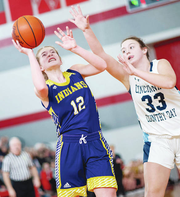 Mechanicsburg's Dani Schipfer (12) scores on a short jump shot during Saturday's game with Cincinnati Country Day.