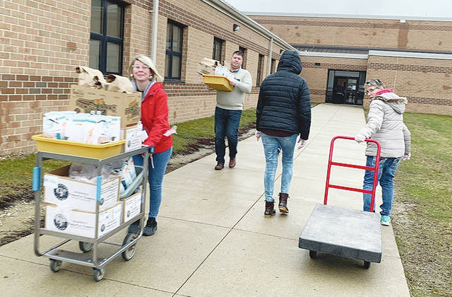 In an effort to make sure every child in the Graham Local School District could receive 5 days of breakfast and lunch, the crew worked together to prepare, package and distribute nearly 5,000 meals on Monday.