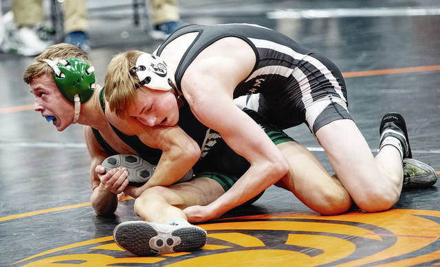 Graham's Nolan Glesser (right) wrestles Brandon Sauter of Batavia at 113 pounds during Saturday's Division II district tournament at Wilmington. Gessler advanced to state by winning the district title.