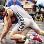 Graham wins district wrestling title, sends 8 to state