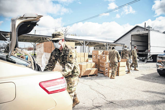 "The 837th Brigade Engineer Battalion of the Ohio National Guard assisted the Second Harvest Food Bank of Clark, Champaign & Logan Counties by distributing food relief at their ""Drive Thru Pantry"" on Friday at the Champaign County Fairgrounds."