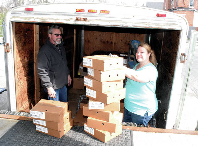 Terry Rittenhouse helps deliver 1,585 pounds of Bob Evans sausage patties to the Caring Kitchen on Thursday. Assistant Director Tara Jordan received the donation, which was unloaded by several shelter residents. Executive Director Marilyn Cohn said 2,250 bottles of hand soap were donated by Bath and Body Works. The soap will go to first responders. Other donations to the shelter have included jigsaw puzzles and coloring books. The Caring Kitchen is sheltering eight individuals, who must remain within the shelter except to go to work. Caring Kitchen can shelter up to 17 people. Cohn said the shelter is receiving weekly food donations from Second Harvest and continues to provide to-go lunches and dinners. She said the shelter can use donations of to-go containers, cleaning products and face masks. Anyone wishing to make a donation can call 937-653-8443.
