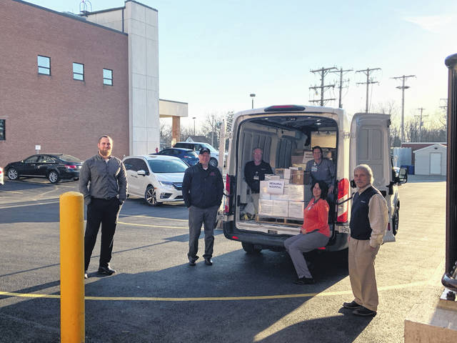 Pictured delivering and receiving the PPE donation are, left to right: Ben Ernst, Honda; Rob Blankenship, Honda; Dave Miller, Memorial Health; Kristine Rausch, Memorial Health; Adena Gwirtz, Memorial Health; and Mark Vallera, Memorial Health.