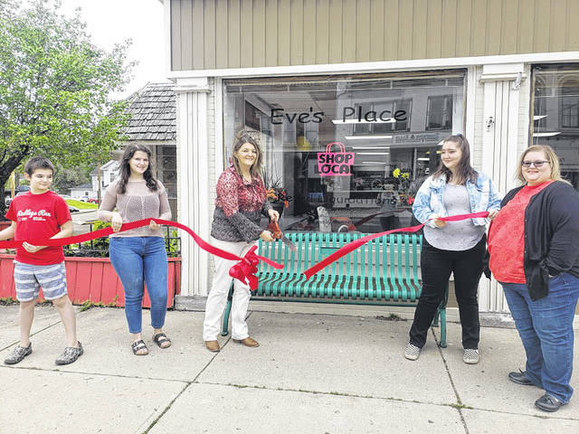 The Champaign County Chamber of Commerce held a ribbon-cutting May 15 for the new location of Eve's Place, 122 S. Main St., Urbana. Eve Zinn, the owner of the retail liquidation store, celebrated with close family. From left are Wyatt Zinn, Montana Zinn, Eve Zinn, Kansas Zinn and Misty Centers.