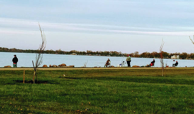 Bank fishing is heavy at Indian Lake, shown here with physical distancing guidelines being followed.