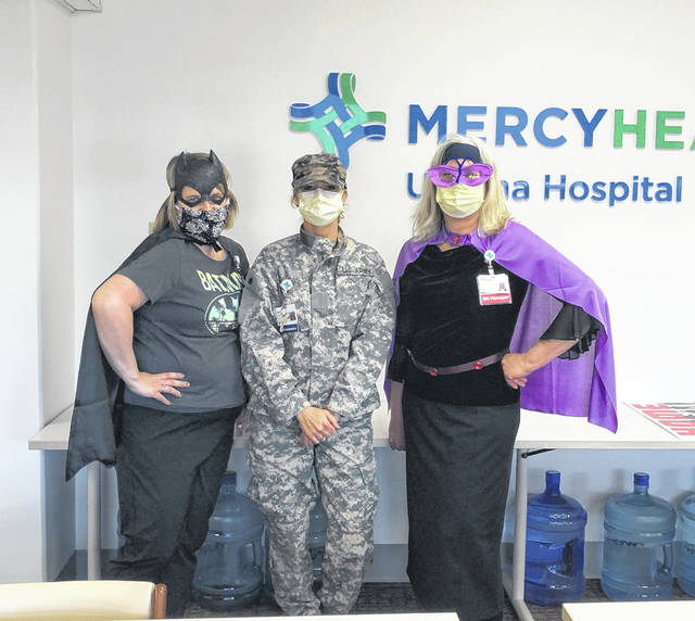 Tuesday was National Superhero Day and Mercy Health's care teams at Springfield Regional Medical Center and Urbana Hospital celebrated by wearing favorite superhero shirts and costumes, as well as masks and capes (outside patient rooms). From left are Adrianne Kiser, Urbana Hospital administrative assistant; Jamie Houseman, Urbana Hospital president; and Theresa Kahle, Urbana Hospital nursing manager, senior behavioral health.