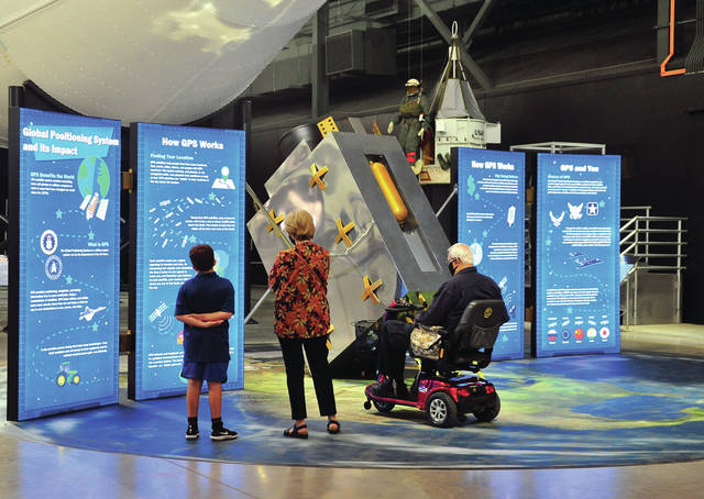 A family checks out one of the new displays at the National Museum of the United States Air Force during a family/employee day prior to the official reopening of the museum on July 1.