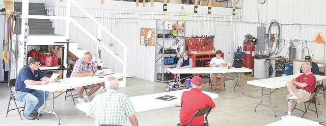From left are Champaign County Fair Board Vice President Max Perry, President Wayne Cook, Secretary Meredith Bodey and Treasurer Nancy Valentine at Thursday's fair board meeting in the fairgrounds' maintenance building.