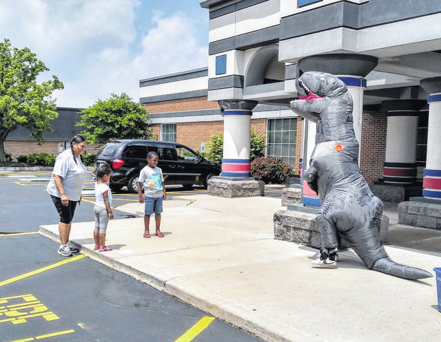 Dewey the Dinosaur was at the Champaign County Library on Thursday handing out information on the Summer Reading Program, which is going virtual this year. All ages are invited to sign up at champaigncountylibrary.beanstack.org. Library doors remain locked, but the staff is offering curbside services and there are plenty of activities and online resources for children and adults. Learn about them all at the library's main website, champaigncountylibrary.org