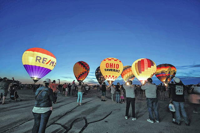 In this file photo from the 2019 Champaign County Balloon Fest, pilots line up their balloons for a glow event. The festival will not occur this year due to the COVID-19 pandemic concerns, but is scheduled to return in 2021.