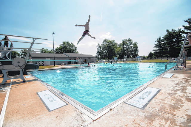 Grant Hower of the YMCA Day Camp takes full advantage of the pool's diving board on Wednesday, July 1. The pool opens to the local public on Friday, July 3. See story for details and limitations.