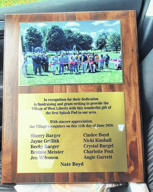 On Monday, this plaque was presented to the Spray N Play Splash Pad Committee by the village of West Liberty. The committee celebrated opening day of the splash pad at Lions Park on June 10. Committee members are Sherry Barger, Jayne Griffith, Becky Barger, Bretnie Meister, Jen Wilcoxon, Cindee Boyd, Nicki Kimball, Crystal Burgel, Charlotte Fout, Angie Garrett and Nate Boyd. To keep up with splash pad info, join the Facebook group Spray N Play West Liberty.