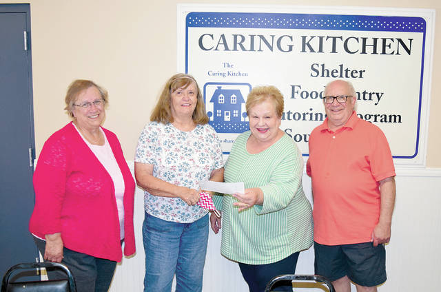 Urbana High School's class of 1965 was unable to hold a 55th year class reunion due to the COVID-19 pandemic, so class members decided to donate $1,000 in reunion funds to the Caring Kitchen. From left to right, Cheryl Siegenthaler, Donna Hays, Caring Kitchen Executive Director Marilyn Cohn and Marty Reich gather in the Caring Kitchen dining room on Tuesday.