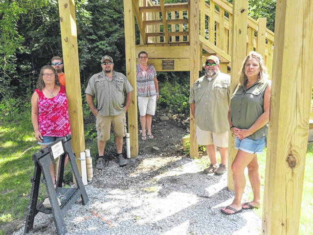 The shooting platform was dedicated in memory of local contractor Neil Yoder, who assisted in its construction. His wife, Diane Yoder, is flanked by representatives of Whitetails Unlimited, who contributed the building materials and assisted in its construction. From left are Sallie Workman, Casey Gannon, Scott Workman, Diane Yoder, Keith McNutt and Becky McNutt.