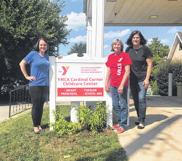 Pictured from left are Champaign Family YMCA Before & After Care and Camp Director Nicky Naylor; YMCA Cardinal Corner Childcare Site Administrator Debbie Woodruff, and UMC Pastor Karen Montgomery.