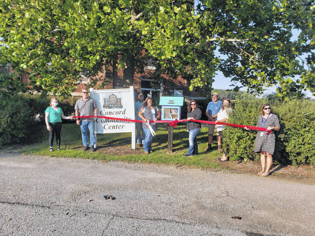 From left are Sara Neer, Walter Stevenson, Chrissy Yoder, Alex Rockwell, Tonya McGuire, Jeff Kizer, Brittany Lewis and Jenny White at a ribbon cutting for the new Little Free Library at Concord Community Center Park .