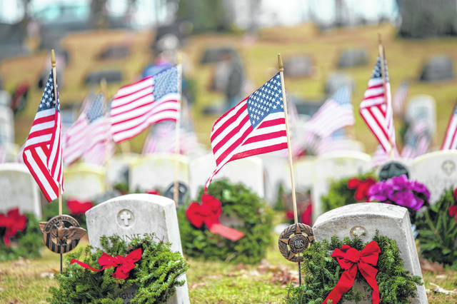 This photo shows wreaths placed by veterans' graves in Oak Dale Cemetery during last year's Wreaths Across America ceremony.