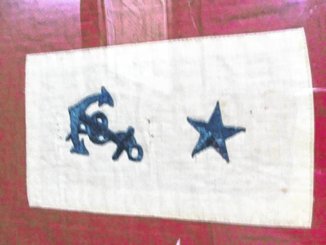 This Blue Star Flag represents one member of a family in service in the Navy.