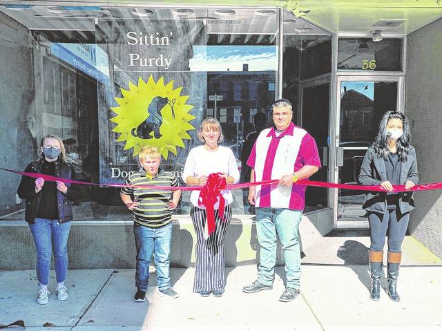 The Champaign County Chamber of Commerce held a ribbon-cutting Oct. 17 for Sittin' Purdy Dog Grooming, 36 Monument Square, Urbana. From left are Sara Neer, Elius Feucht, Wendy Pyfrin, Jeff Pyfrin and Rachel Casey. For info, call the new business at 937-594-2728.