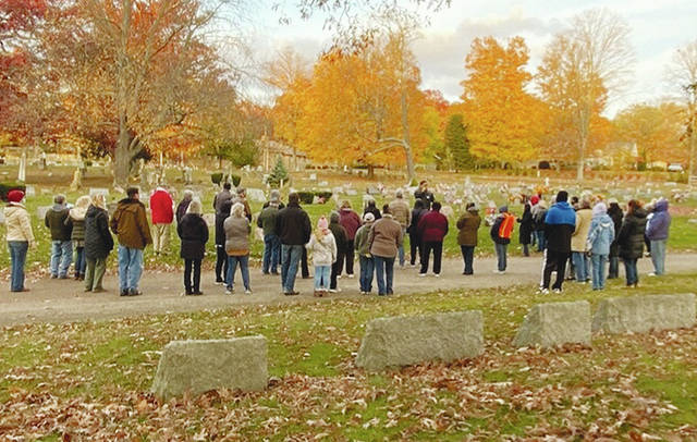 With a backdrop of golden fall foliage, John Bry addresses one of the groups in the CCPA Cemetery Tour at Oak Dale last weekend.
