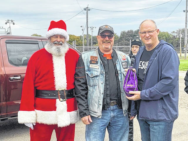 The American Thunder Motor Club gives generously to Community Christmas efforts during their annual toy run. From left are Dan Shockey; Randy Roach, ATMC president; Pastor Dan Leiker of River of Life Christian Center.