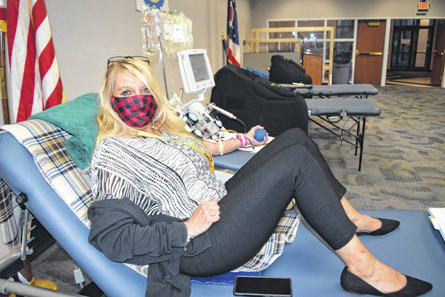 Blood donors Nov. 24 included Cindee Boyd of West Liberty, whose husband, Scott, survived a 2016 farm machinery accident and received 108 units of blood, plasma and platelets during emergency surgeries.