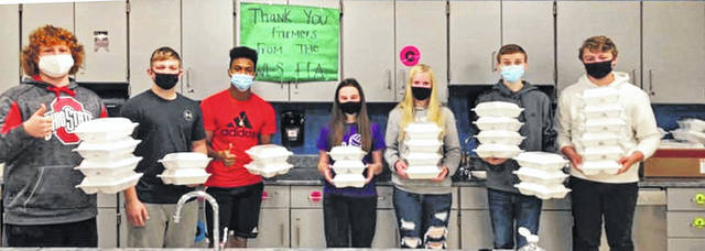 The West Liberty-Salem FFA Chapter prepared and delivered over 100 meals to local farmers the week of Nov. 2-6. Chapter members nominated farmers/farm families to receive meals in appreciation for the food they provide. The WL-S Feed the Farmers program continues to grow. The Airport Cafe provided pie. From left are Kalieb Laing, Wylie Harbour, Dylan Glunt, Shae Stoner, Carlee Hausler, Devin Grime and Hayden King.