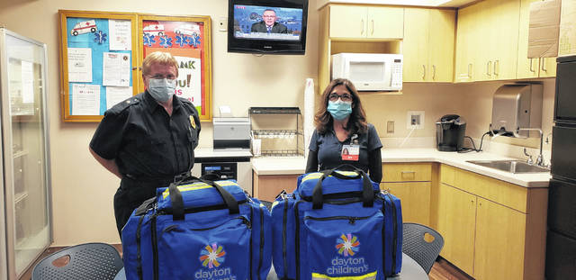 Pictured with the new pediatric EMS trauma bags are Mechanicsburg Assistant Fire Chief/EMS Coordinator Steve Castle and Dayton Children's Hospital EMS Coordinator Heather Koss.