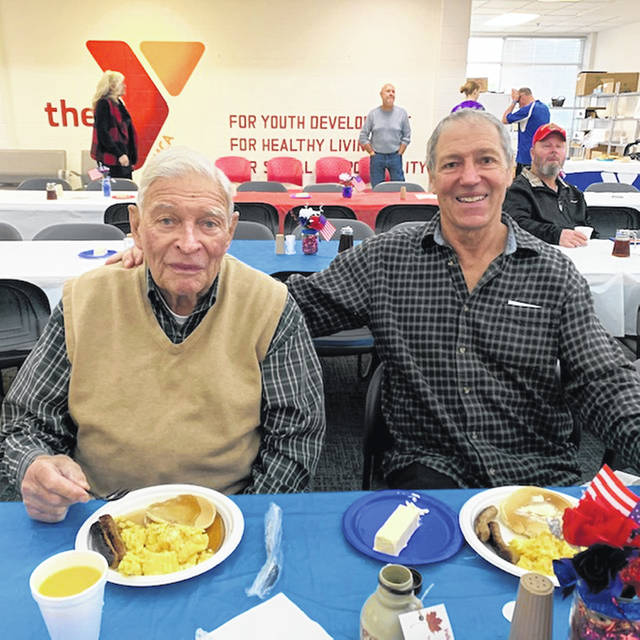 Marc Stadler and his Navy veteran father, Charles, enjoy their meal at last year's event.