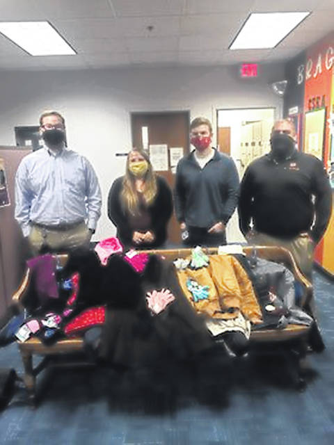 Zachary Walden, Chelsea Vaughan, Dillon Bricker and David Still at Champaign County Jobs & Family Services with donated coats.