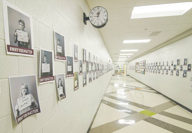 The main hallway at Urbana Junior High School is lined with individual images of students expressing why they matter to someone.