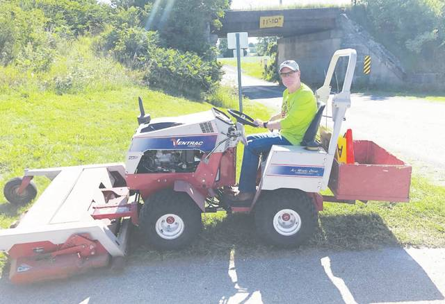 Simon Kenton Pathfinders maintenance volunteer Brian Newman of Urbana mows along the trail this past summer. Equipment such as this mower requires annual maintenance and frequent upgrades.