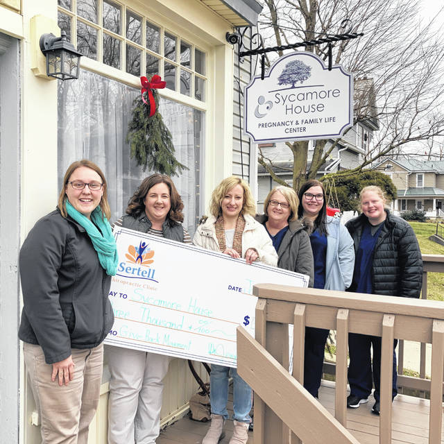 Sertell Chiropractic Clinic presented the Sycamore House Pregnancy & Family Life Center with a check for $3,000 through the clinic's Give Back Movement! program. The Sertell clinic expressed appreciation to patients and local businesses that made the donation possible. Shown are Sertell staff members and Sycamore House Director Sarah Metherd. From left are Natalie Frueh, Dr. Jennifer Sertell, Sarah Metherd, Sharon Kelley, Holly Reed and Emily Holland.
