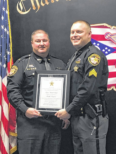 Detective Ryan M. Black, right, of the Champaign County Sheriff's Office was promoted to the rank of sergeant on Tuesday. Shown in the photo with Sheriff Matthew Melvin, Black joined the Sheriff's Office in 2013 and has been assigned to various divisions, including Uniform Patrol and Criminal/Special Investigations.