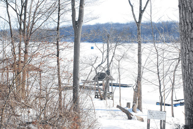 Kiser Lake is attracting winter hobby activity as part of it is iced over. Ice fishermen's tents dotted the lake's surface to the west over the weekend. This photo was taken from a trail on the north side of the lake.
