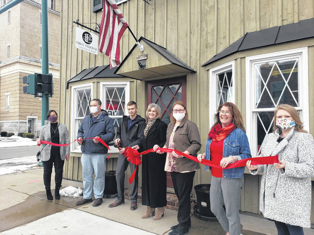 The Champaign County Chamber of Commerce held a ribbon-cutting ceremony on Feb. 24 to welcome First Federal Community Bank (Mortgage Office), 300 N. Main St., Suite 1, Urbana. Bank hours are 9 a.m.-5 p.m. weekdays. For info, call Braden Lewis at 937-565-4515. From left are Leah White, Doug Crabill, Braden Lewis, Lisa Ballenger, Natalie Frueh, Lynette Moody and Sara Neer.