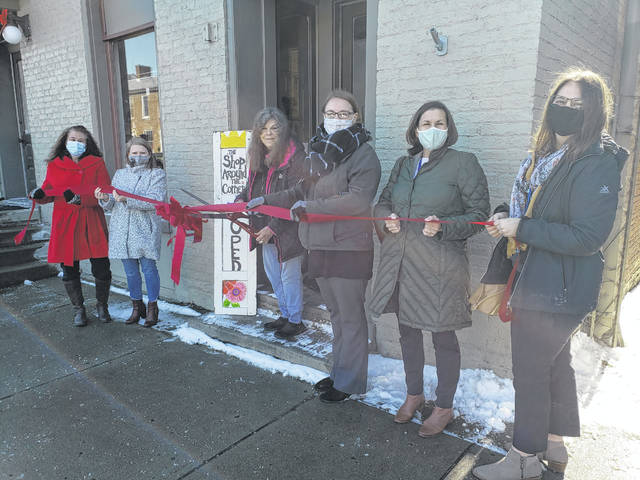The Champaign County Chamber of Commerce held a ribbon-cutting Feb. 12 for The Shop Around the Corner, 121 Scioto St., Urbana, which has handmade artwork, jewelry, home goods, paintings, photography, natural bath products, repurposed furniture, houseplants and more. From left are Lynette Moody, Sara Neer, owner Gretchen Reed, Natalie Frueh, Jenny White and Amy Kerrigan.