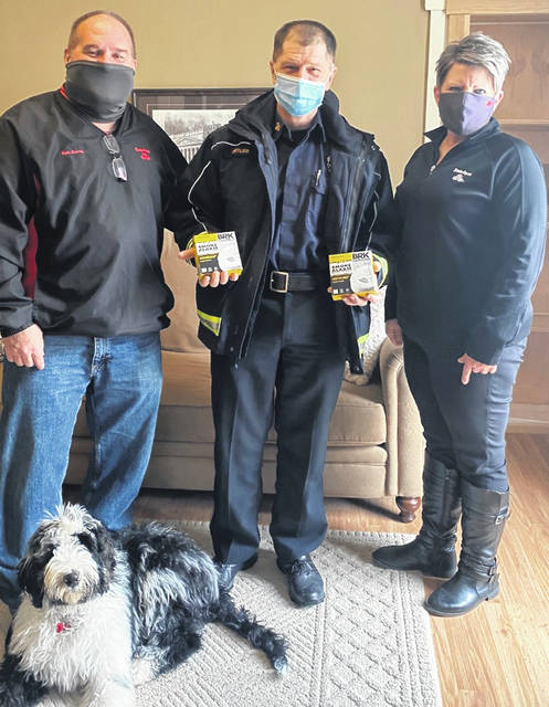 Local State Farm Agent Ron Burns donated 40 smoke alarms to the Urbana Fire Division to distribute to residents at no cost. Shown are, from left, Burns with his pooch Jameson, Urbana Fire Chief Dean Ortlieb and Burns agency Office Manager Julie Massie. This month, 65 State Farm agents in Ohio delivered over 2,800 smoke alarms to local fire departments. Three of five home fire deaths are due to a lack of working smoke alarms on the premises, according to the National Fire Safety Association.