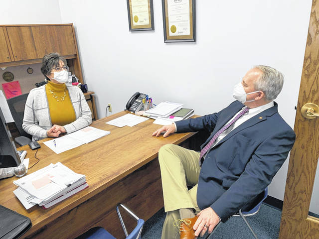Champaign County Treasurer Robin Edwards meets with state Auditor Keith Faber on Thursday during his visit to county government offices.