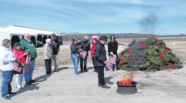 DAR members held a flag and wreath retirement ceremony at the Detwiler barnyard. The wreaths were from the Wreaths Across America project honoring deceased veterans and the flags were those no longer suitable for display. Following the burning, ashes are buried.