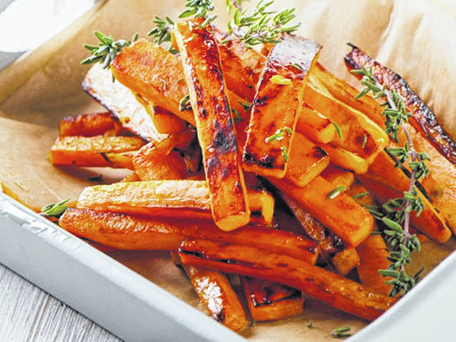 Cut sweet potatoes into fry strips seasoned with olive oil, salt, pepper, paprika, garlic power and onion powder and place them into an air fryer on 400 degrees Fahrenheit until done.