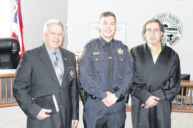 Pictured from left are Urbana Police Chief Matthew Lingrell, new officer Noah Curl and Judge Gil Weithman.