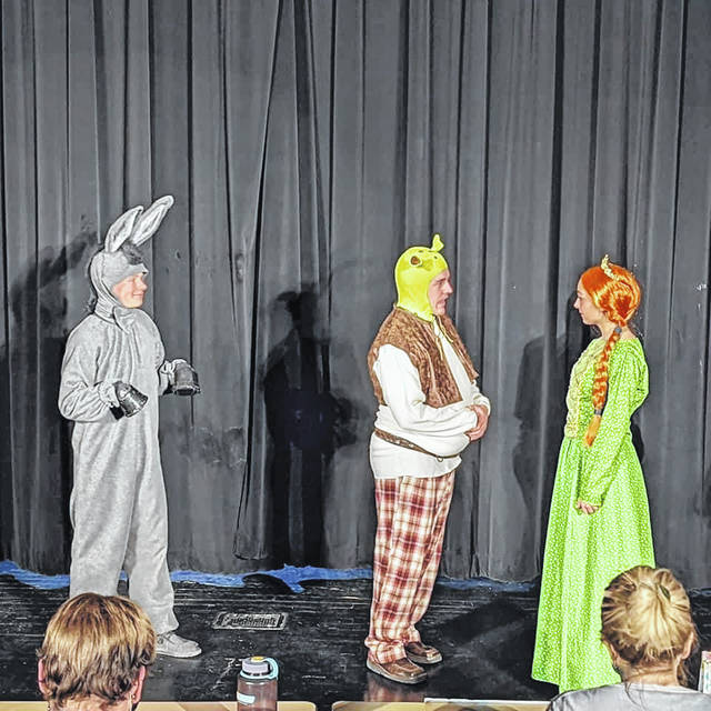 "West Liberty-Salem's production of ""Shrek the Musical"" features Shrek, portrayed by Andrew Stoner, Fiona, portrayed by Megan Adams, and Donkey, portrayed by Andrew Kimball."