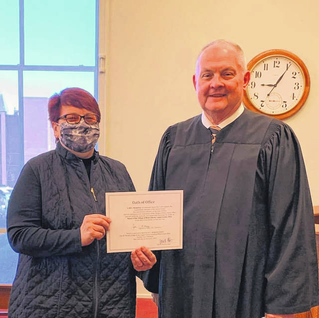 Jill McKelvey, left, a West Liberty Village Council member since 2008, was sworn into the office of mayor by Judge Dan Bratka, right, on Feb. 24. Chance Carroll resigned as mayor two days earlier due to health issues.