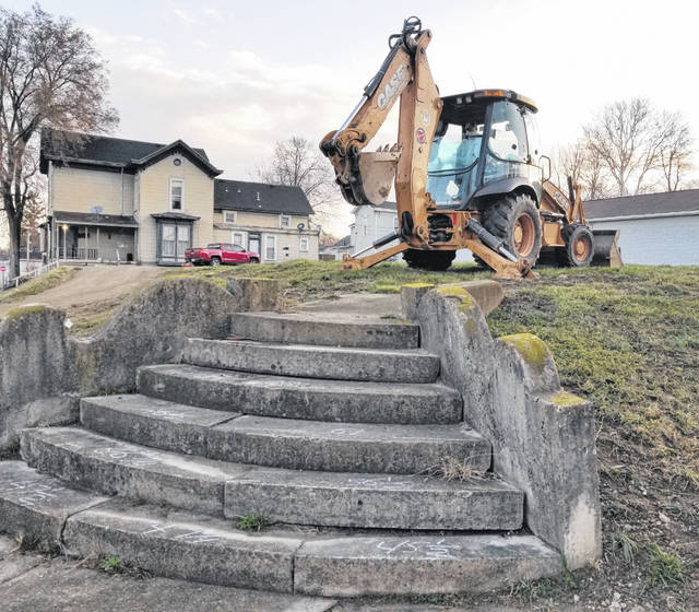The steps of historic significance at the corner of Miami and Russell streets in Urbana are shown prior to their dismantling and removal for preservation.
