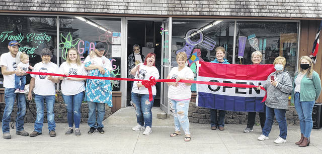 The Champaign County Chamber of Commerce held a ribbon-cutting April 17 for Family Country Cuts, now located at 211 W. Main St., Saint Paris. Owner Janie Douglas had a re-grand opening for her new location. From left are Brad Evans, Jessica Evans, Braylee Evans, Taylor Keeran, Aaron Rutherford, Arabella Rutherford, Janie Douglas, Regina Wagner, Marcia Bailey, Brenda Cook, Katy Cupps and Sara Neer.